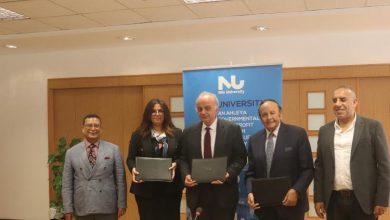 صورة تعاون بين جامعة النيل  والجمعية المصرية للتكنولوجيا المالية